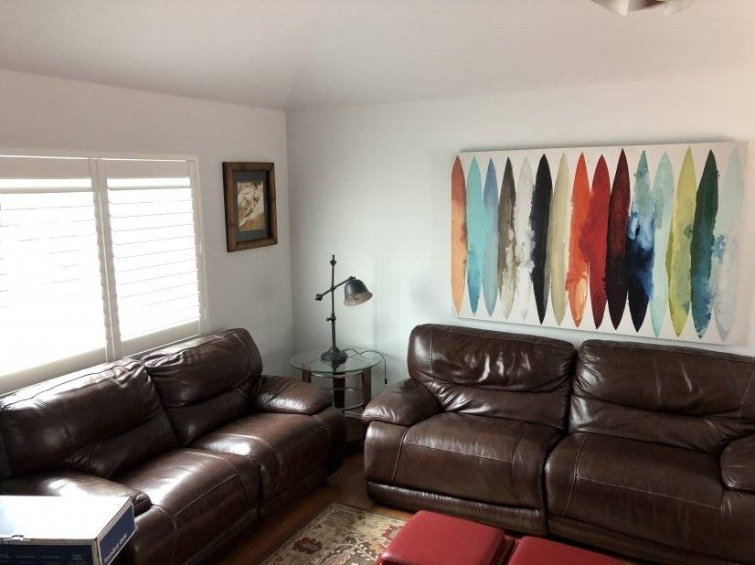 """Family room with 50"""" flat screen TV"""