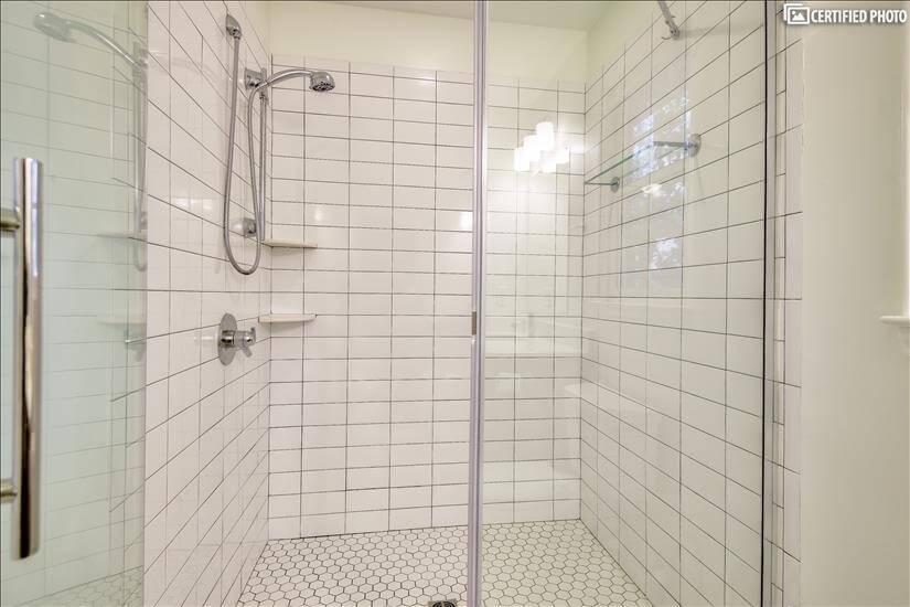 Beautiful subway tiled walk-in shower