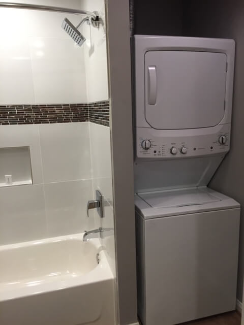 Hall Bath With Tub & Shower. Full Size Washer and Dryer