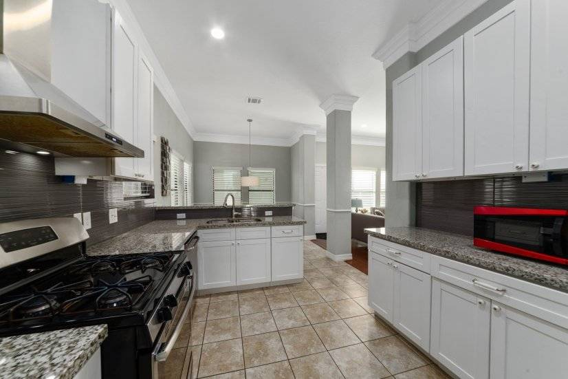 Fully Equipped Kitchen Including Dishes and Cookware