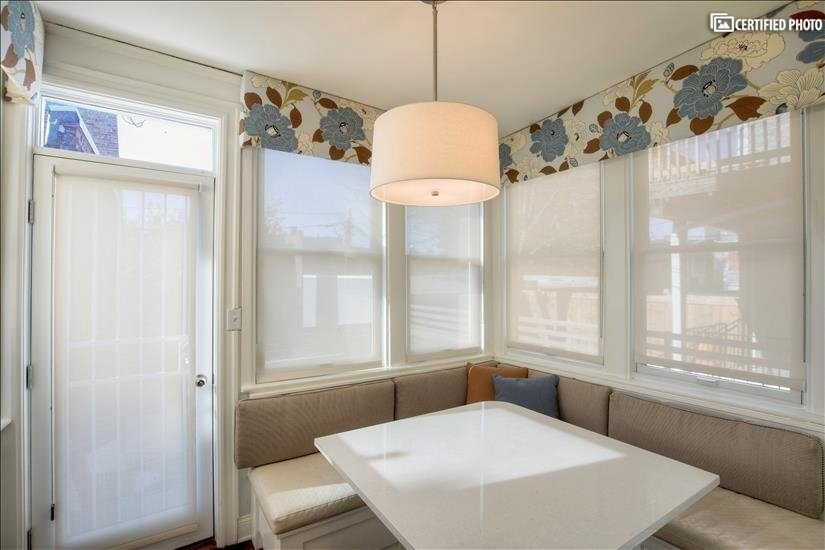 Light-filled breakfast room off the kitchen with banquette
