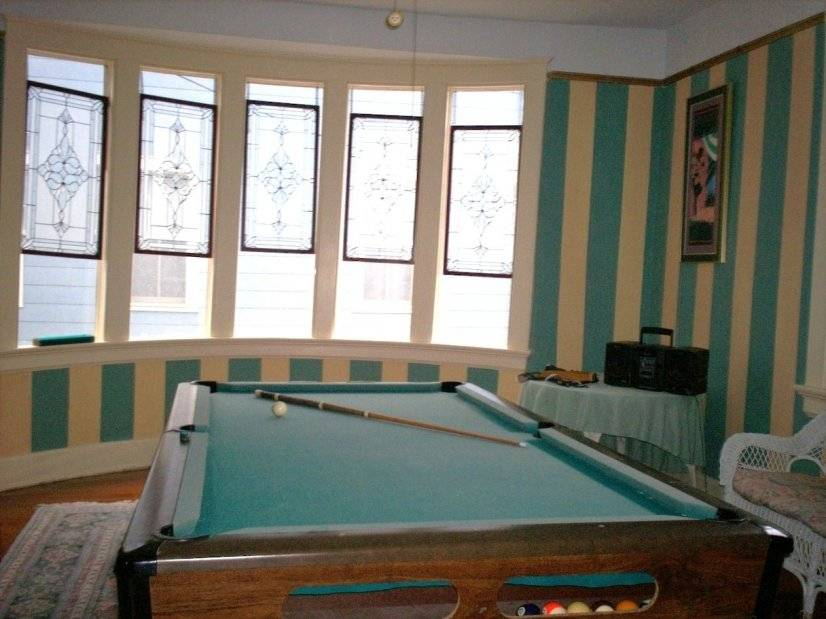 Game room with pool table/ ping pong table