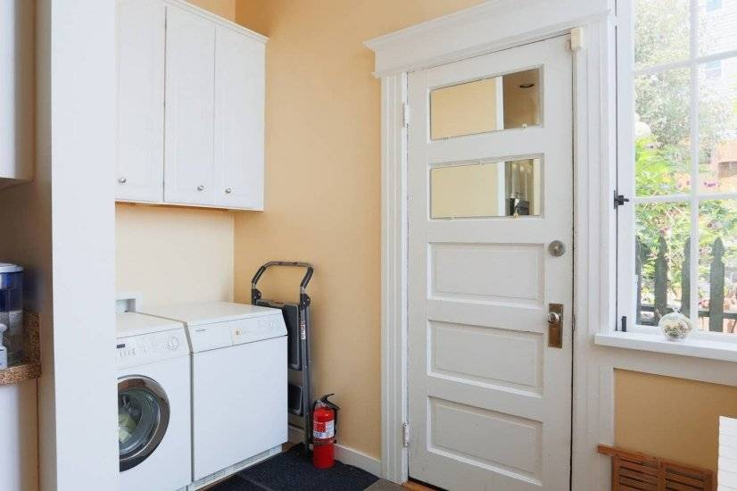 Bright, open laundry room conveniently sits next to kitchen