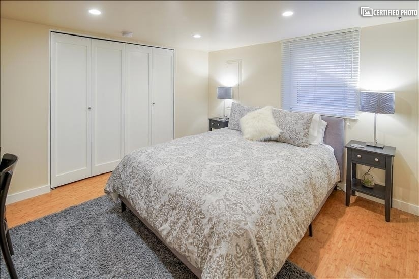 Queen sized bed in the larger bedroom