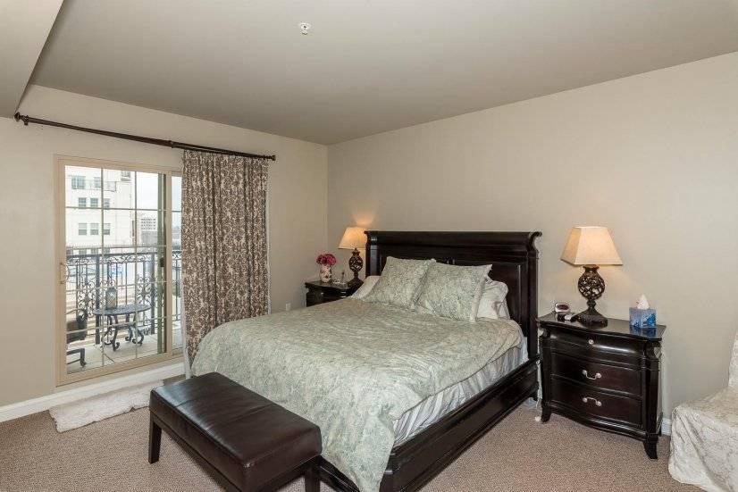 Master bedroom with balcony overlooking pool