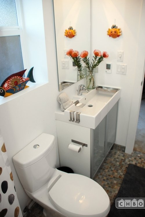 Bathroom with dual flush Toto toilet and Grohe fixtures