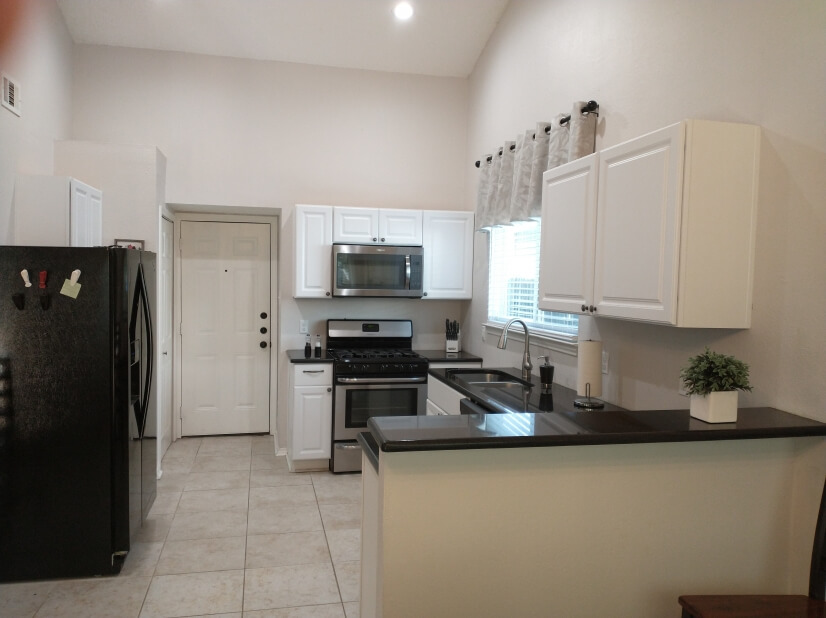 Fully outfitted kitchen with large pantry.