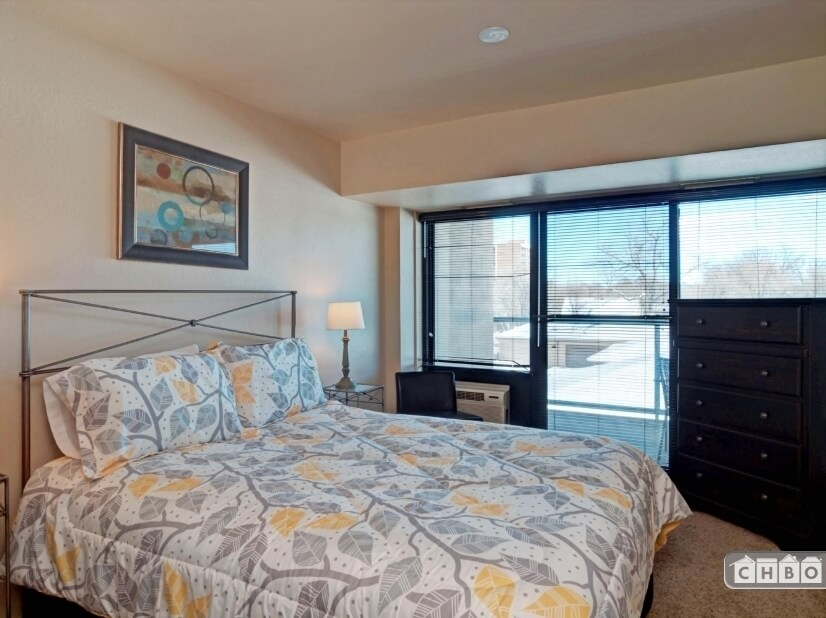 Queen bed with walk out balcony