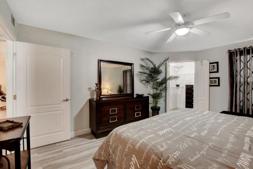 Bedroom Includes Dresser w/Mirror, End Tables, Ceiling Fan.