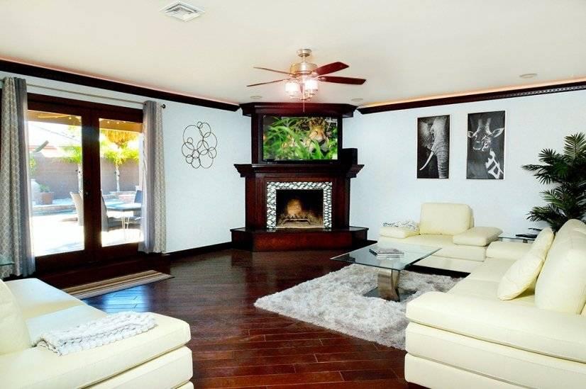 Living Room- oversized leather sofas, LG Smart LED TV