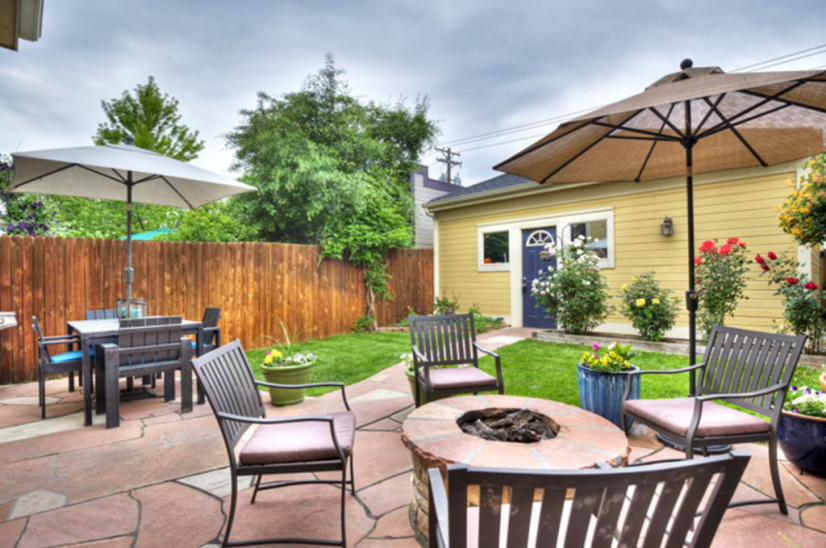 Private backyard with fire pit and gas bbq