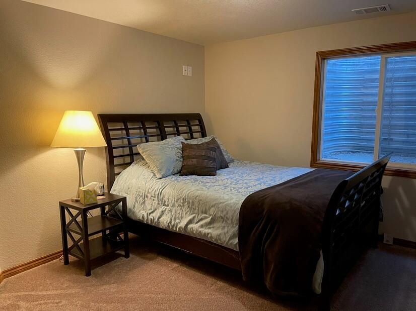 Basement bedroom w/ queen bed