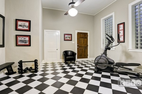Exercise room has free weights & bench.