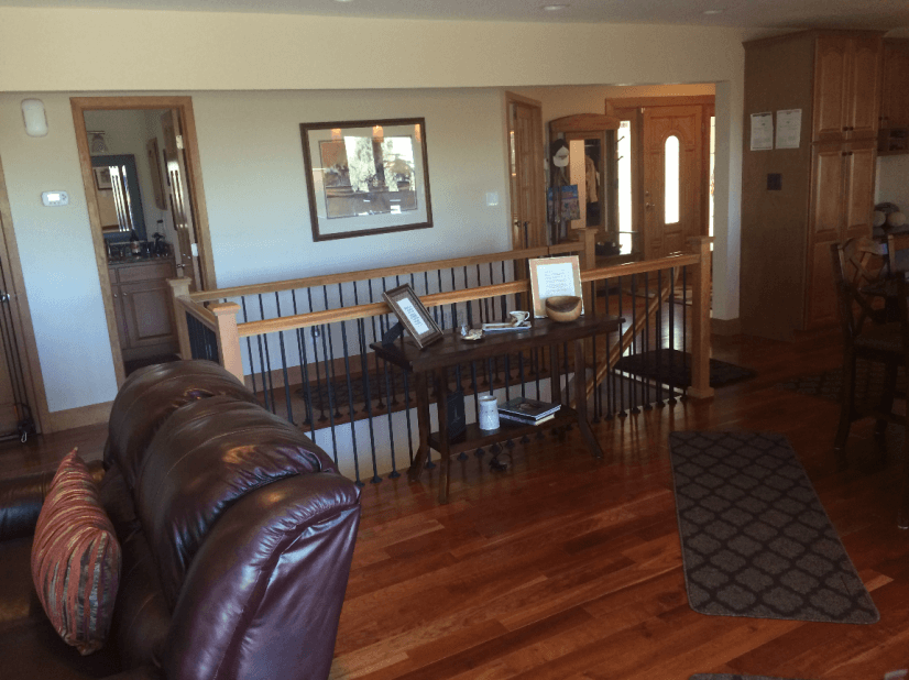 Entryway to Living Room, Powder Room, and Kitchen Main Level