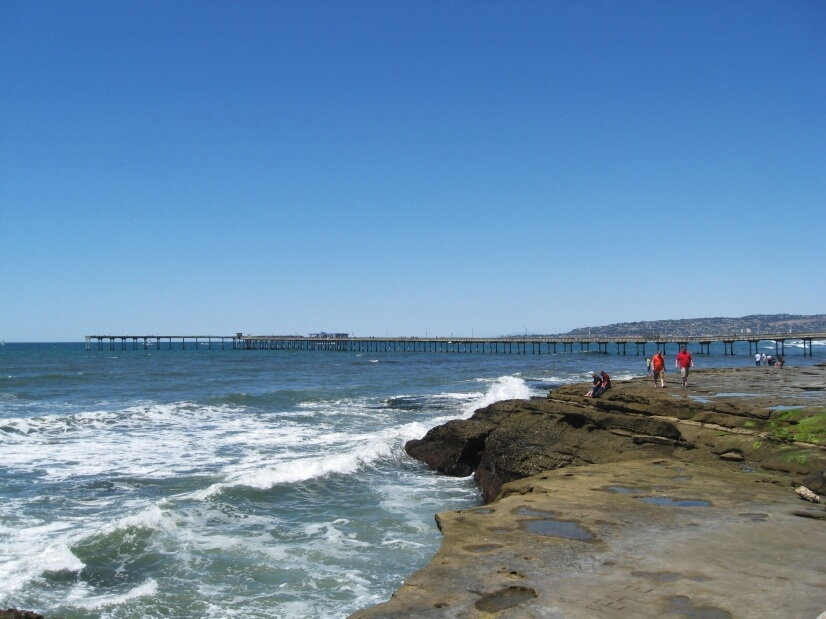 The sandstone cliffs with OB Pier in the distance