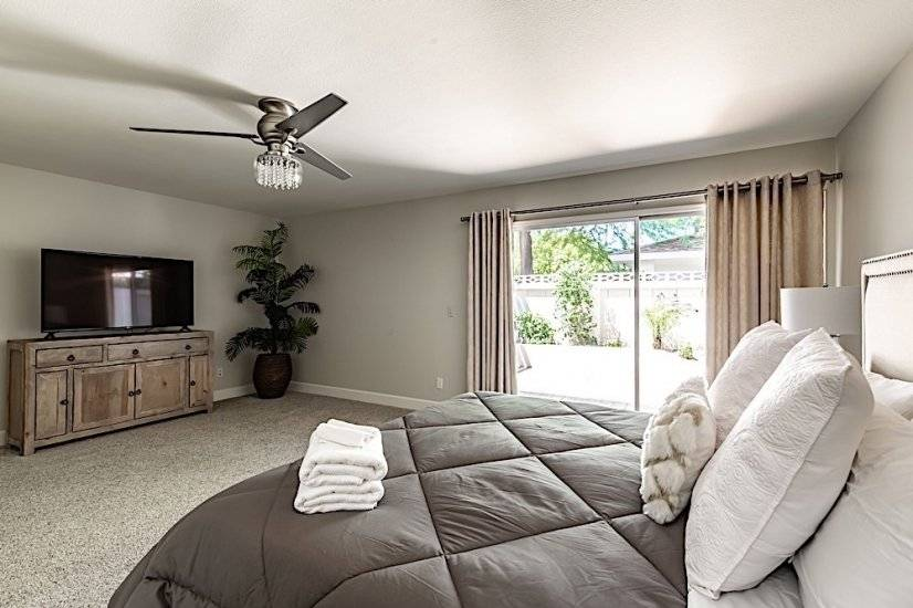 Master Bedroom - King Sized  Bed + Large HD TV