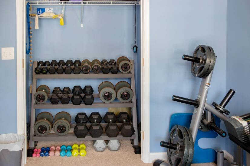 Home Gym has dumbbells & plate weights