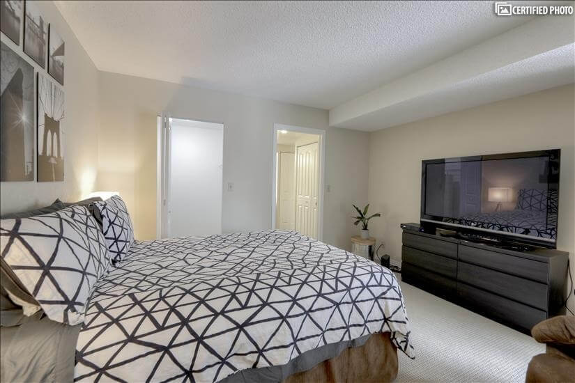 "Master Bedroom with 65"" TV"
