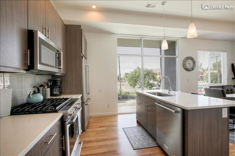 Gourmet kitchen - stainless steel appliances & gas range
