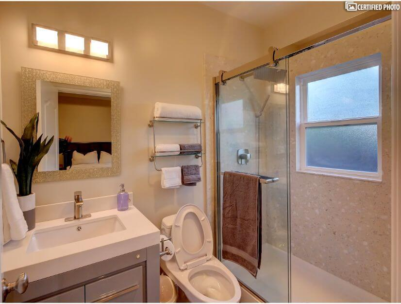 Studio B - Full size bathroom with new GOSHE shower system.