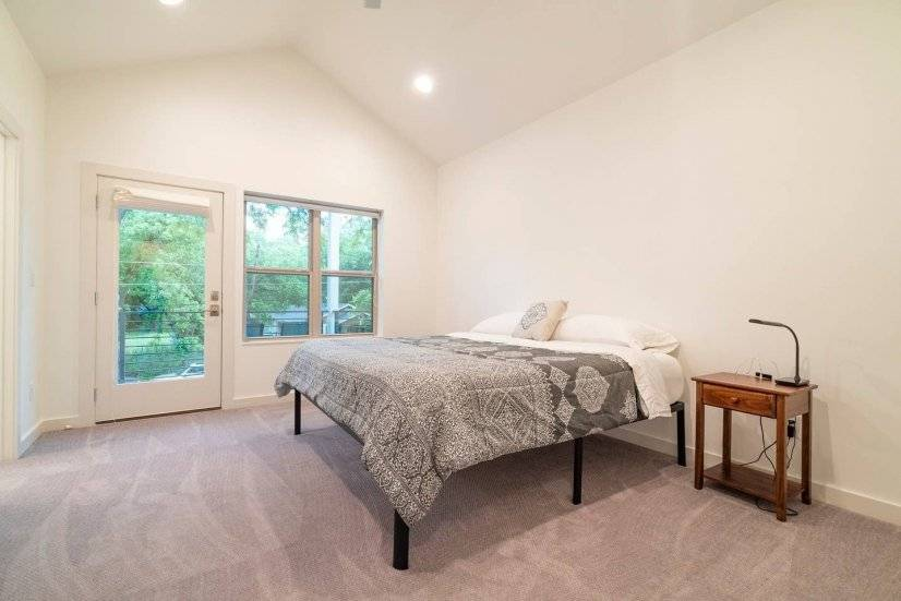 Master bedroom with King size bed and balcony