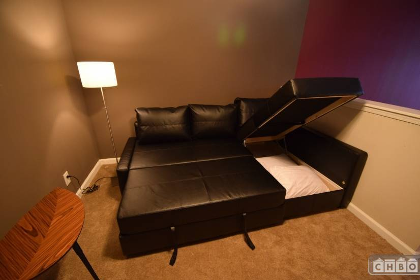 Couch converts to a bed for extra guests! Storage for beddin