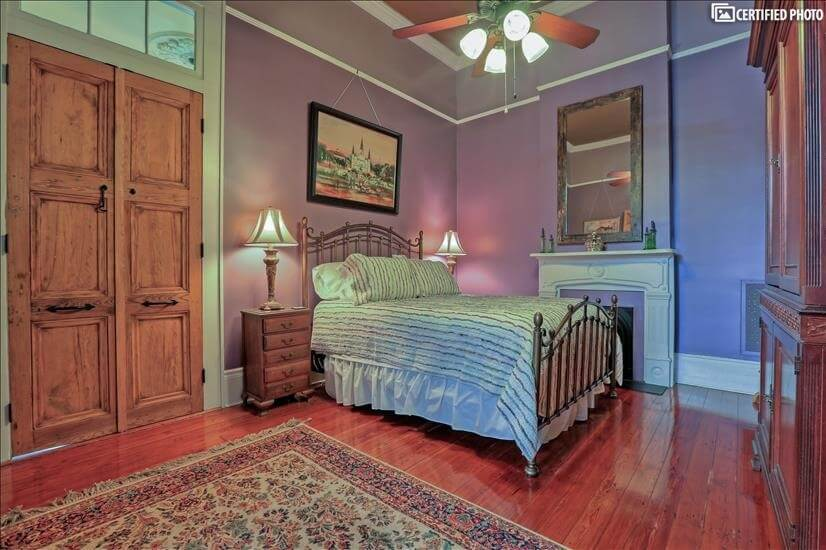 Beautiful queen guest room filled with New Orleans charm