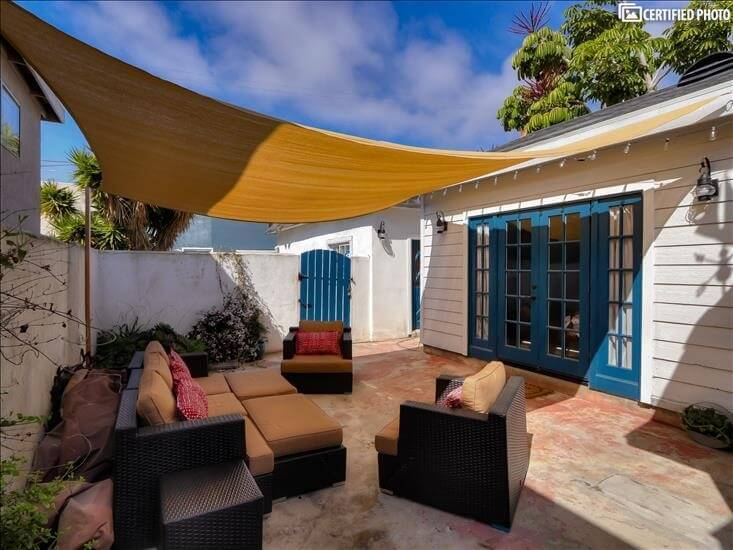 Back Patio with access from 2 bedrooms and Kitchen