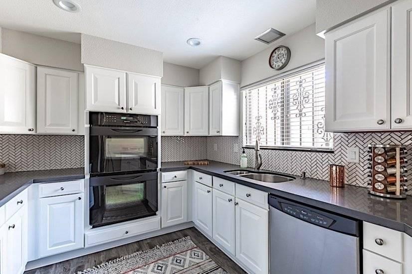 Kitchen - Quartz countertops, Stainless Steel & Black Appli.