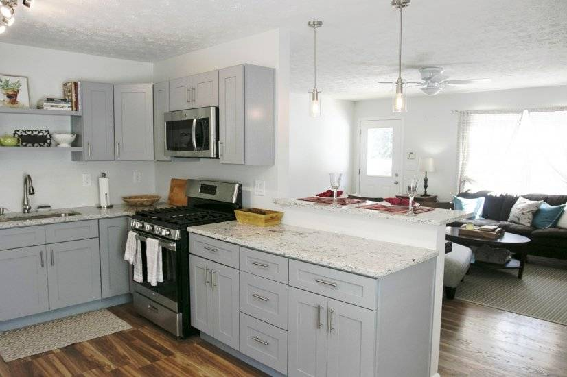 Brand new kitchen with new stainless steel appliances.