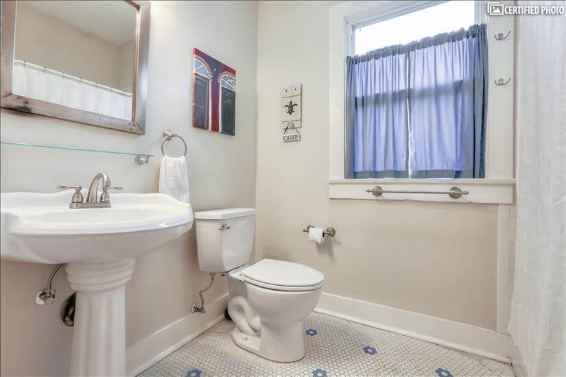 Tub/shower combination plus linen closet.