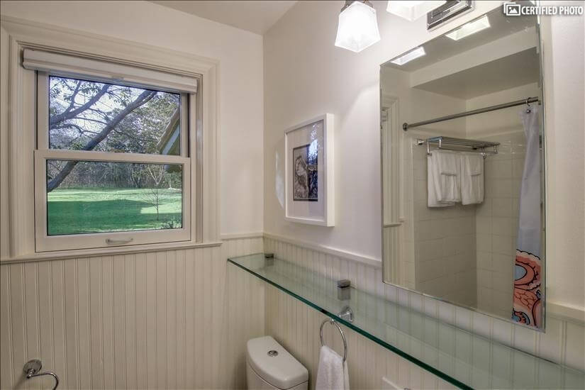 Bathroom has a shower/tub combination. and natural light.
