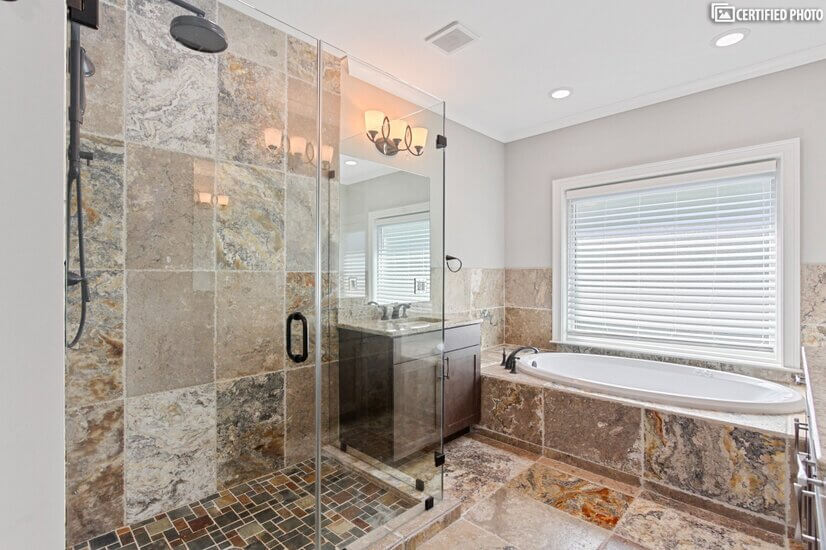 master bathroom with tavertine tiles throughout