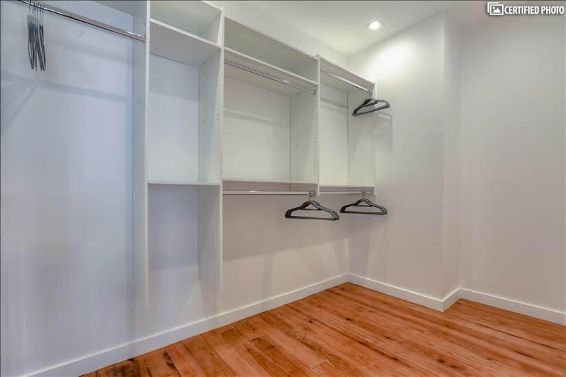 Custom-built closets in master bedroom