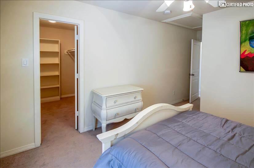 Bedroom 2 with dresser & large walk in closet