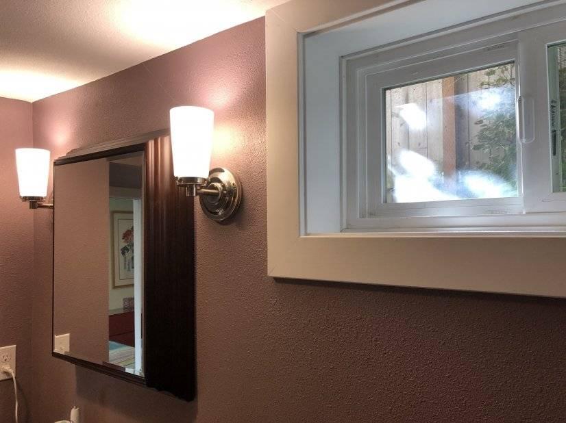 Bathroom wood-framed mirror and window.