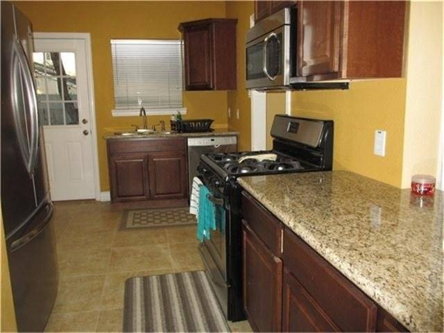Kitchen with granite counter top& stainless steel appliances