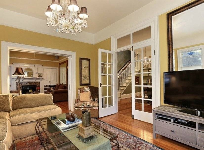 Living room with large picture window and neighborhood views