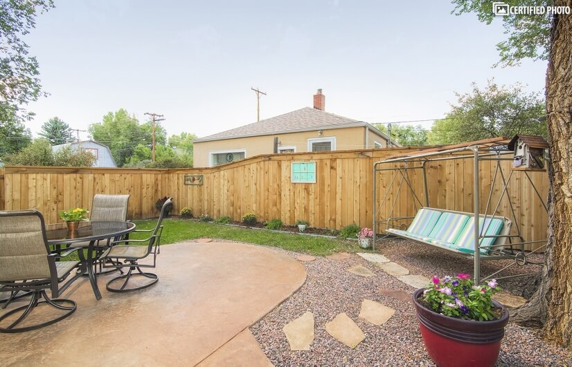 Inviting Backyard, Large Shade Trees & Reclining Swing!