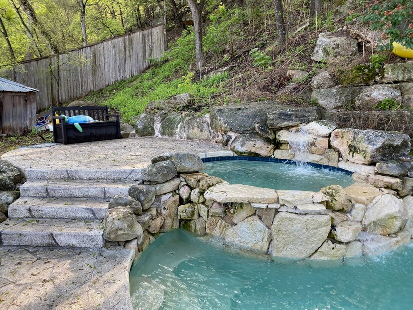 Built-in hot tub with waterfall