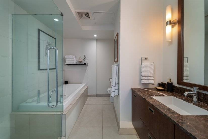 Master bath includes long and deep tub for a
