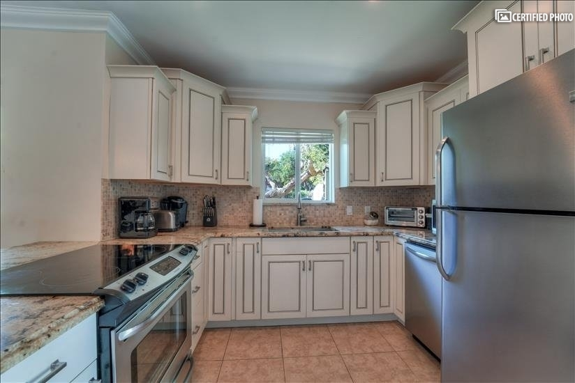 Stainless steel appliances, fully updated, stocked kitchen.