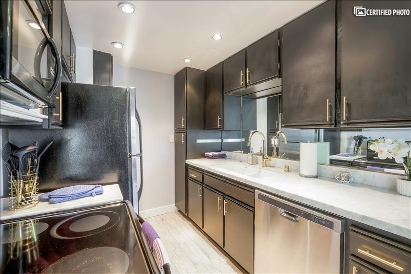 Fully stocked kitchen, espresso machine, hot water maker