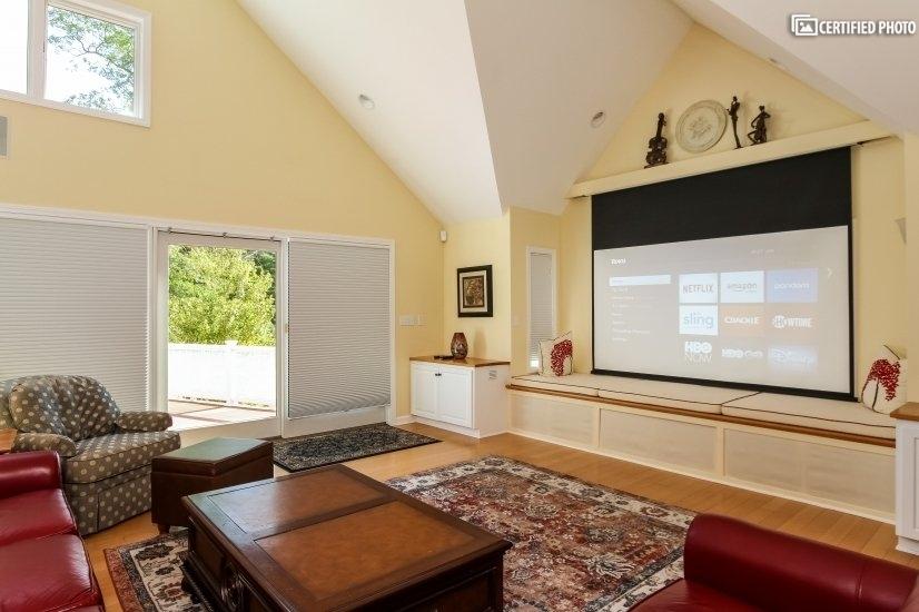 "108"" home theater screen retracks to hidden position."