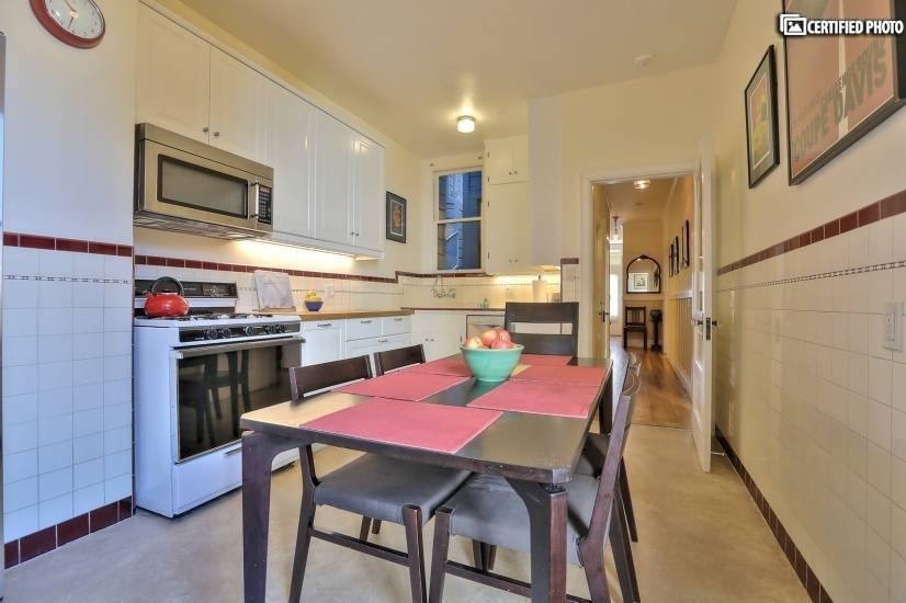 Kitchen features original refinished cabinets and dishwasher
