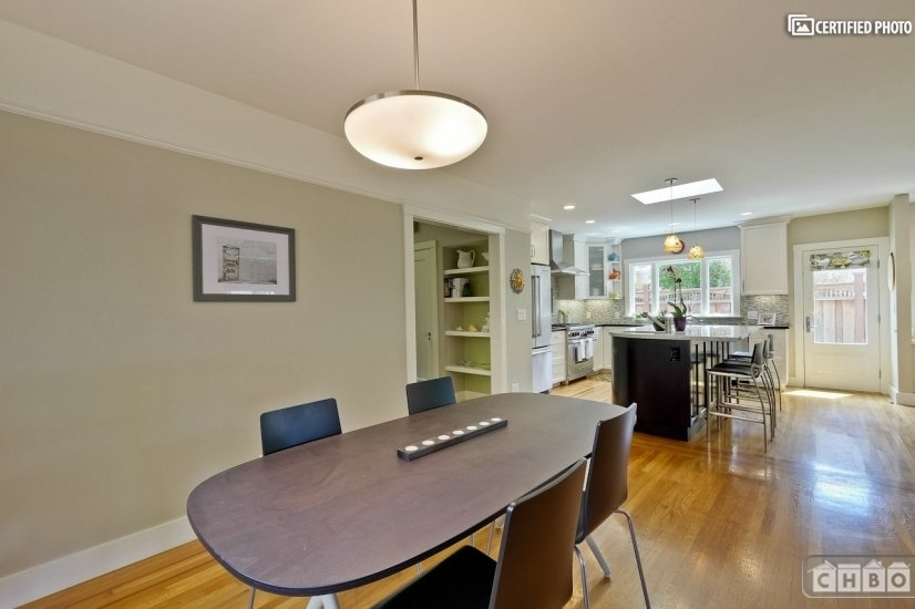 Modern dining area which flows into kitchen