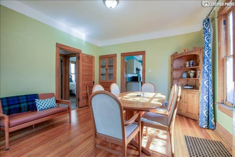 Dining room with view into kitchen, teak loveseat