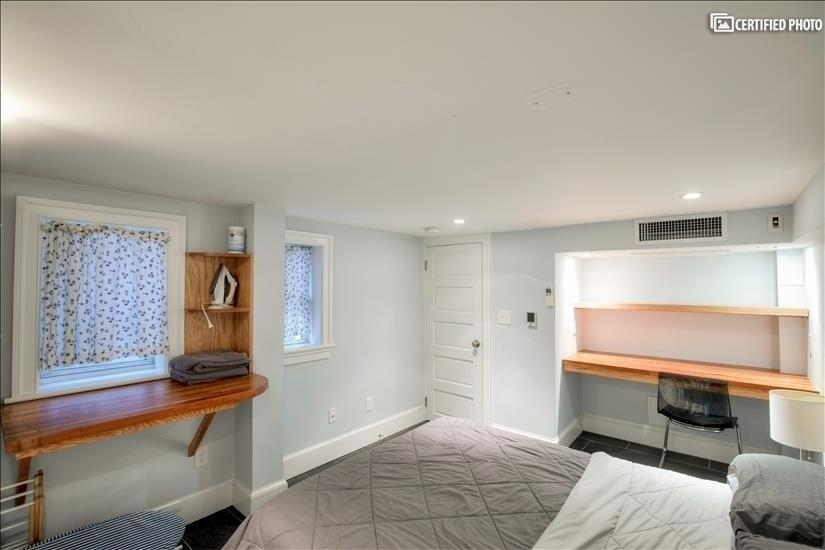 Built-in desk in basement bedroom
