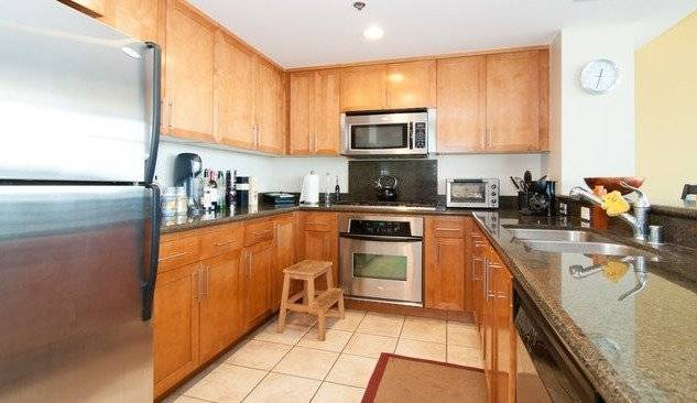 Full featured kitchen with stainless steel appliances.