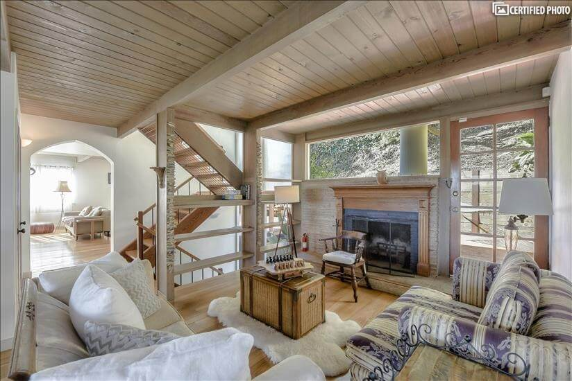 Formal LR w/fireplace and view of deck